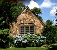 my stone cottage with hydrangeas blooming