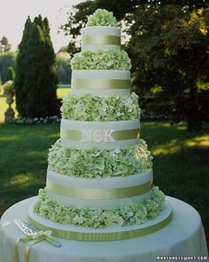 Beautifully decorated cake with green hydrangea and  the bride & groom's initials - via: Martha Stewart <3