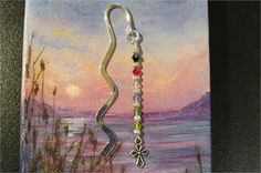 Salvation Bookmark. Scripture bookmark - Great gift for a Sunday School teacher, Pastor, shower Favors, Secret Pal   Wavy, flat silver tone iron bookmark approximately 3 1/4 in length with dangling 4mm bicone Swarovski crystals and 4mm round ribbed silver tone metal alloy spacers with a double sided antiqued silver tiny cross charm dangling at the bottom.   Beaded and dangling portion is approximately 2 3/4 in length.   All products used are lead-free.   The crystals are in the foll...