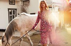 Embracing florals, Lise Olsen models Michael Kors Collection dress