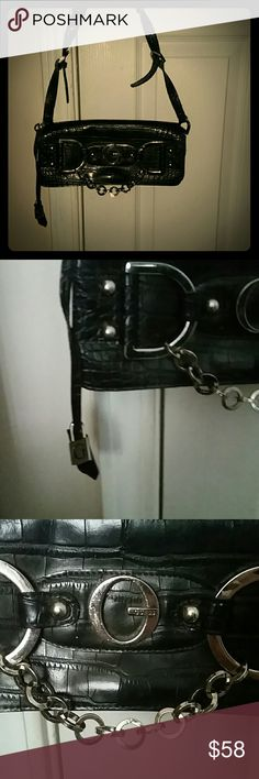 """Vintage Guess purse Never used and no longer made! Genuine leather. Lots of detailing on leather and a """"G"""" lock charm on side. Also a lot of silver chain detailing, this purse is in AWESOME SHAPE. HAS A SNAKESKIN PRINT ON LEATHER,  ADJUSTABLE SHOULDER STRAP. NEVER USED ONCE. YOU WILL LOVE THIS BAG! BNWOT Guess Bags Shoulder Bags"""