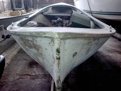 An old fishing boat under renovation