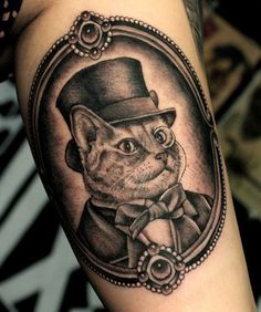 Engraving style very detailed cat gentleman portrait tattoo on arm