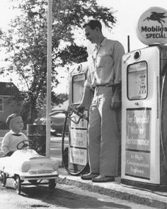Original vintage old photos reproduced into contemporary prints. All photographs are chemically processed in photo labs and in great condition. Boy Rides Pedal Car To Gas Station - BW Photo Reprint Boy Rides Pedal Car To Gas Station - BW Photo Reprint Drive In, Old Gas Pumps, Vintage Gas Pumps, Old Pictures, Old Photos, Vintage Photographs, Vintage Photos, Antique Photos, Station Essence