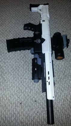 This is my custom Nerf Recon with a Nerf Longstrike barrel & an aftermarket magazine.