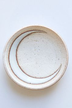 wheel thrown 'catch all' dishes are glazed with a white crescent moon. dish measures approximately 4.5 across. handmade in nyc