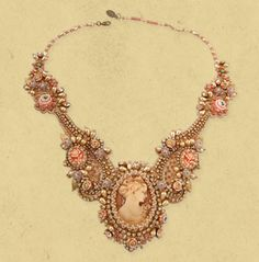 Luxurious Michal Negrin necklace made of lace adorned with central cameo, decals, Swarovski crystals, rose and brass elements and beads.