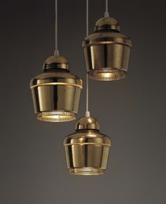 """scandinaviancollectors: """"ALVAR AALTO, Set of three Golden Bell ceiling lights (model no. A330), designed in 1954 for Artek Oy, Finland. Material brass and perforated brass. Manufactured by..."""
