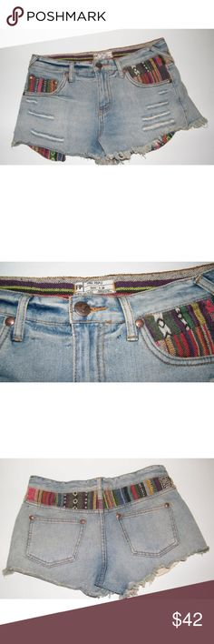 """NWOT Free People Distressed """"Coachella"""" Shorts Super cute distressed cutoffs from Free People. Shorts have a distressed hem and a woven tribal pattern on the pockets and back. Worn once, no defects. Free People Shorts Jean Shorts"""