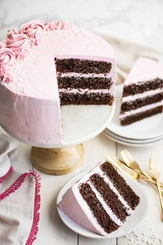 Layers of chocolate cake, filled and frosted with a sweet and delicate raspberry Swiss meringue buttercream, make this pretty cake perfect for celebrations.