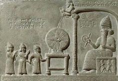 The sun-god Shamash holding a ring of coiled rope and a rod