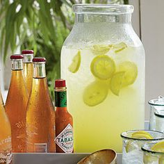 Cajun Lemonade - 2 cups lt rum, 1 can frozen lemonade concentrate thawed, 1 tsp hot sauce, 1 liter club soda, crushed ice, lemon slices