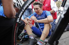 Italy's Giorgia Bronzini cries after crossing the finish line to take a fourth place in the women's road race over 127.4 kilometers (79.2 miles) of the Road Cycling World Championships in Ponferrada, north-western Spain, Saturday Sept. 27, 2014. (AP Photo/Daniel Ochoa de Olza)