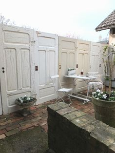 Salvaged matching doors repurposed into a fantastic privacy fence for the patio area.