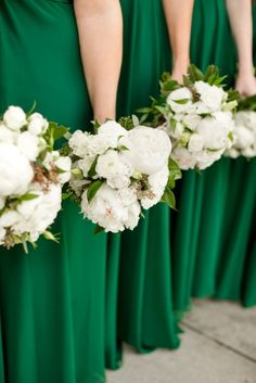 Green wedding with white bouquets.
