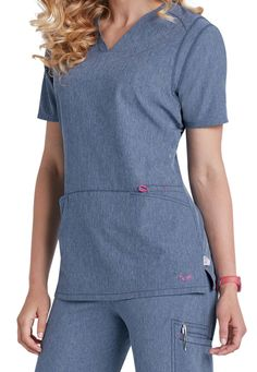 For those days when the same-as-usual scrub just won't do, reach for this fabulous Smitten scrub top (in Heather Blue) instead. Double shoulder seams and fitted back seams add streamlined structure, while front pouch pockets with extra accessory compartment keep all your essentials safely stashed.