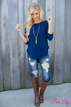 We absolutely adore the classic navy blue color of this 3/4 sleeve blouse!
