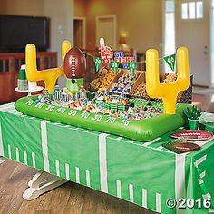 Keep your football party guests' plates full with this Football Snack Stadium Décor Idea. Doubling as party decorations, make your snack table setup ...