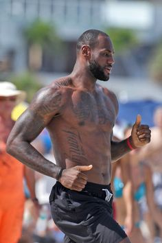 LeBron James hits the beach and surf of Miami to film a commercial.