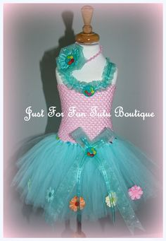 Thanks you for Visiting Just For Fun Tutu Boutique!    This mint color flower tutu dress is lovely hand made designed along with a hand made