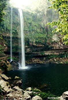 Misol Ha waterfall near Chiapas, Mexico. We swam here. :) Also where they filmed part of the original Predator movie.