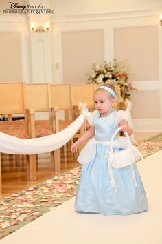 not Cinderella unless she wants to be... flower girl gets to dress up as her favorite disney princess, heck yeah!