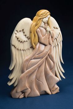 This freestanding intarsia angel by Kathy Wise is a divine addition to any Christmas decor. Learn more about the projects in Scroll Saw Woodworking & Crafts Holiday 2015 (Issue 61) at http://scrollsawer.com/2015/11/05/scroll-saw-woodworking-crafts-holiday-2015-issue-61/.
