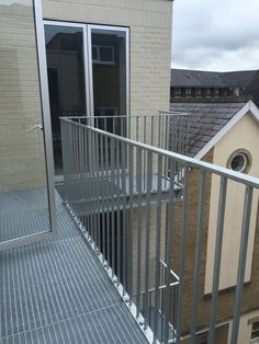 Elefant gratings, galvanised steel balconies, lightwell
