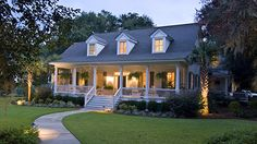 Nicely lit cape cod style with a porch.