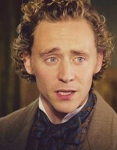 Curly Blond - Ranking Tom Hiddleston's Hairstyles, From Golden Retriever to Frizzy Rocker | Bustle