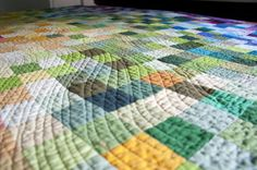 Rainbow patchwork and wavy quilting.
