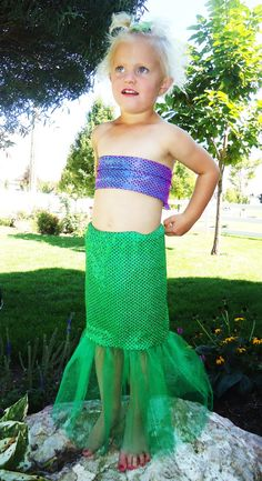Use the fin idea but with more tulle at the bottom. Cut top shimmery fabric into scales to cover a tee for the top.