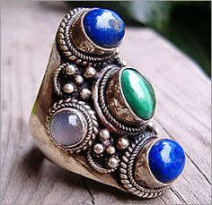 Google Image Result for http://www.semi-precious-stone.com/gifs/malachite-ring1.jpg