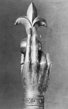 Arm reliquary with fleur de lis
