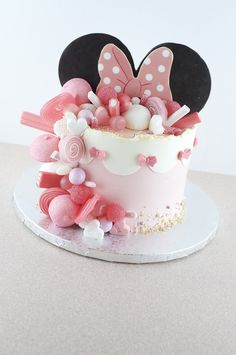 pink and white fondant, minnie mouse pics, silver tray, candy decorations, pink bow Minnie Mouse Cake Decorations, Minnie Mouse Cupcake Cake, Minni Mouse Cake, Minnie Mouse Theme Party, Minnie Mouse Birthday Cakes, Bolo Minnie, Mickey Mouse Cupcakes, Mickey Cakes, Cupcake Cakes