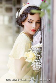 Trevillion Images - glamorous-retro-woman-beside-fence