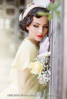 Trevillion Images - glamorous-retro-woman-beside-fence