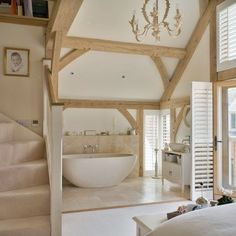 Country bathroom barn conversion. Open plan bedroom and bathroom increases light good use of space.