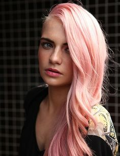 A long blonde straight coloured multi-tonal pink hairstyle