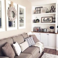 Replace family photos with mirrors and simplistic art and decor. Mirrors enlarge a room and decor allows the buyer to personalize their own space. Home Staging Tips and Ideas Improve the Value of Your Home on Frugal Coupon Living. - April 27 2019 at Living Room Mirrors, Cozy Living Rooms, New Living Room, Apartment Living, Home And Living, Apartment Ideas, Cozy Apartment, Living Room Wall Decor Ideas Above Couch, Wall Mirrors