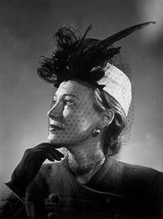 Circa 1947: A woman modelling a hat with veil and feathers. (Photo by Hulton Archive/Getty Images)  - The Cut