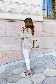 White jeans and neutral chunky sweater