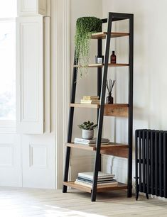 This ladder-style storage shelf is perfect for books, potted plants and other ornaments. It's a great way to store and show off some of your most treasured pieces. Pictured: Baltimore Storage Ladder from Marks & Spencer. Ladder Shelf Decor, Wooden Ladder Shelf, Home Decor Shelves, Ladder Shelves, Ladder Storage, Living Room Decor, Living Spaces, Bookshelves In Living Room, Home Comforts