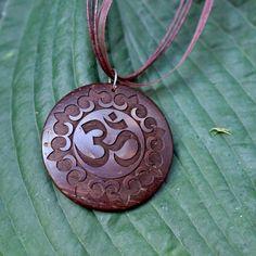 Om Carved Coconut Necklace $22.00