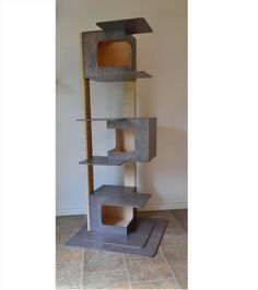 Cat tree has three pods **sold in the province of quebec only**  Dimensions: 24 in x 24 in x 72 inches high (the base is a little wider for better stability 32 po x 32 po) Three cushions included. Gray color and sisal on both sides. Interior finished the same color as the sisal.