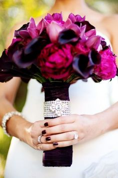 {Venue} Taglyan Complex. {Flowers} Magnolia Flowers: Pink, purple, peonies, lilies, orchids, with crystal detail and brooch.