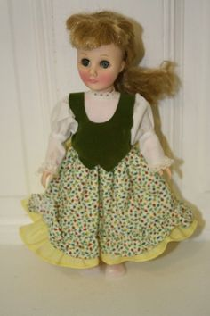 "1975/76 Effanbee sleepy eye doll in yellow skirt with white top 11"". $17.50 Green eyes, blonde hair **small stain on sleeve**"