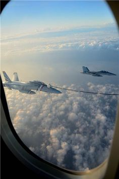 Two United States Navy F/A-18 Super Hornets are shown in these photos during refuelling by a Royal Canadian Air Force 437 Transport Squadron CC-150T Polaris strategic air-to-air refueller from CFB Trenton, Ontario. This was taking place during the Rim of the Pacific (RIMPAC) Exercise 2014. Photos by Master Corporal Melissa Spence, Canadian Forces Combat Camera