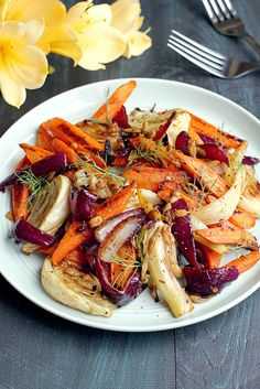 Spicy roasted fennel and carrots is a simple but striking dish that comes together in about 30 minutes. Enjoy it straight up, as a side or in a salad. Baked Fennel, Roasted Fennel, Roasted Vegetables, Veggies, Gourmet Recipes, Cooking Recipes, Healthy Recipes, Vegetable Sides, Vegetable Recipes