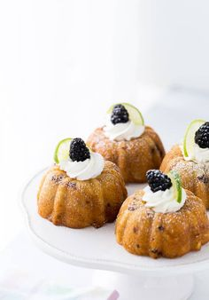 These blackberry lime mojito cakes are deliciously tender and filled with fresh blackberries and rum topped with fresh whipped cream. via @zmansaray